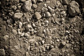 Dry soil and stones of an agricultural field Royalty Free Stock Photo