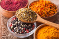 Dry spices in a wooden and glass bowls close-up Royalty Free Stock Photo