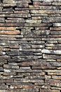 Dry stone wall background stacked high to form a boundary Stock Image