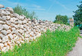 Dry stone wall and grass on a sunny day Royalty Free Stock Image