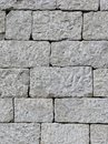 Dry wall made of hand cut granite stones Royalty Free Stock Photo