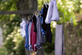 Drying clothes on a clothesline Stock Photos
