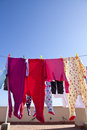 Drying clothes picture of kid pyjamas outside on a clothesline on a roof during a sunny day Royalty Free Stock Image