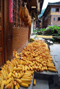Drying corns at farmhouse ethnic minority village in guangxi province china Royalty Free Stock Photo