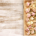 Drying of roses in wooden tray Royalty Free Stock Photo