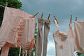 Drying underwear on clothesline old fashoined tights bra and corsets Stock Images