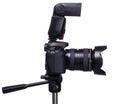 DSLR camera on tripod with external flash Royalty Free Stock Photo