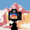 DSLR reflex camera photographing mountain landscape