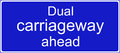Dual carriageway ahead sign road traffic Royalty Free Stock Image