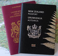 Dual nationality nz and uk passports two united kingdom new zealand on a map of england representing or citizenship Royalty Free Stock Image