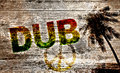 Dub graffiti a rastafari with the text with palm trees Royalty Free Stock Images
