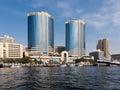 Dubai Creek with Deira Twin Towers Royalty Free Stock Photo