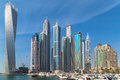 Dubai marina is an artificial canal city built along a two mile km stretch of persian gulf shoreline Stock Photography