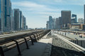 Dubai metro station rail track with modern buildings on the background Royalty Free Stock Photo