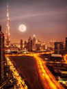 Dubai in moonlight uae full moon night scape downtown modern arabian architecture middle east illuminated city at night Stock Image
