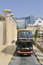 Dubai sightseeing bus open top parked outside new shopping mall Stock Image