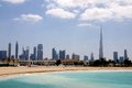 Dubai skyline viewed from the jumeirah beach Stock Photography