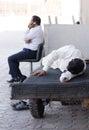 dubai souk workers taking a break time sleep in the daytime, uae