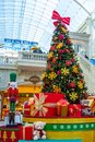 Dubai, United Arab Emirates - December 12, 2018: Decorated Christmas tree with gifts in the mall