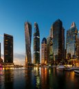 Dubai, United Arab Emirates - February 14, 2019: Dubai marina modern skyscrapers and luxury yachts at blue hour Royalty Free Stock Photo