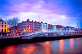 Dublin hapenny bridge ireland at dusk with waterfront and historic ha penny Royalty Free Stock Image