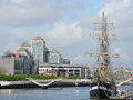 Dublin liffey river modern buildings and tall ship in ireland Royalty Free Stock Images