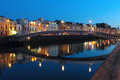 Dublin night scene with ha penny bridge and liffey river lights ireland Royalty Free Stock Image