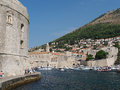 Dubrovnik august footpath at the harbor entrance with ploce gate and fortified old town in background Royalty Free Stock Photography