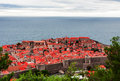 Dubrovnik classic red tiled rooftops with adriatic sea Stock Images