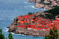Dubrovnik classic red tiled rooftops with adriatic sea Royalty Free Stock Photos