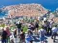 Tourists looking out over panorama view of old town of Dubrovnik from viewing platform
