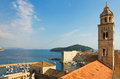Dubrovnik the dominican monastery bell tower and harbor view from above in croatia in a bright sunny day toward old port island Stock Photography