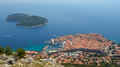 Dubrovnik old town city wall and Lokrum Island Royalty Free Stock Photo