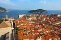 Dubrovnik sunny afternoon panoramic view with the harbor and old from highest point of fortress wall toward town in dalmatia Royalty Free Stock Photos