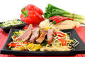 Duck breast with fried noodles Stock Images