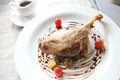 Duck confit roasted duck leg in close up Royalty Free Stock Images