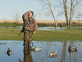 Duck hunter calling ducks a young out hunting Royalty Free Stock Photos