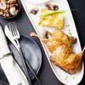 Duck legs confit with potato gratin mushroom sauce restaurant serving and Stock Photography