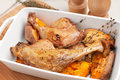 Duck legs roasted with sweet potato Royalty Free Stock Photography