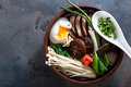 Duck noodles with egg and mushrooms in bowl on dark black stone texture background Royalty Free Stock Photo