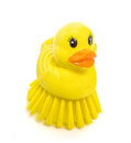 Duck scrubber handy little brush in the shape of a Royalty Free Stock Photos