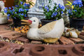 Duck sculpture cheerful decoration in the garden Stock Photos