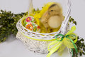 Duck sitting in easter basket yellow with painted eggs Stock Photos