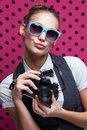 Duckface pouting lips trendy girl in glasses playing the ape with camera Stock Photo