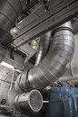 Ducts exhaust duct system of an old ship engine room Stock Photos