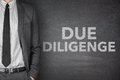 Due diligence on blackboard black with businessman Stock Photo