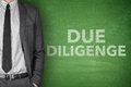 Due diligence on blackboard black with businessman Stock Photography