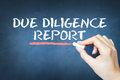 Due diligence report text written with chalk on blackboard Royalty Free Stock Photo
