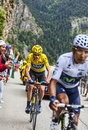 Duel at alpe d huez france july the british cyclist christopher froome wearing the yellow jersey following quintana while climbing Stock Photos