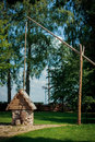 A dug well, large shadoof well sweep in Bareikiskes, Lithuania Royalty Free Stock Photo
